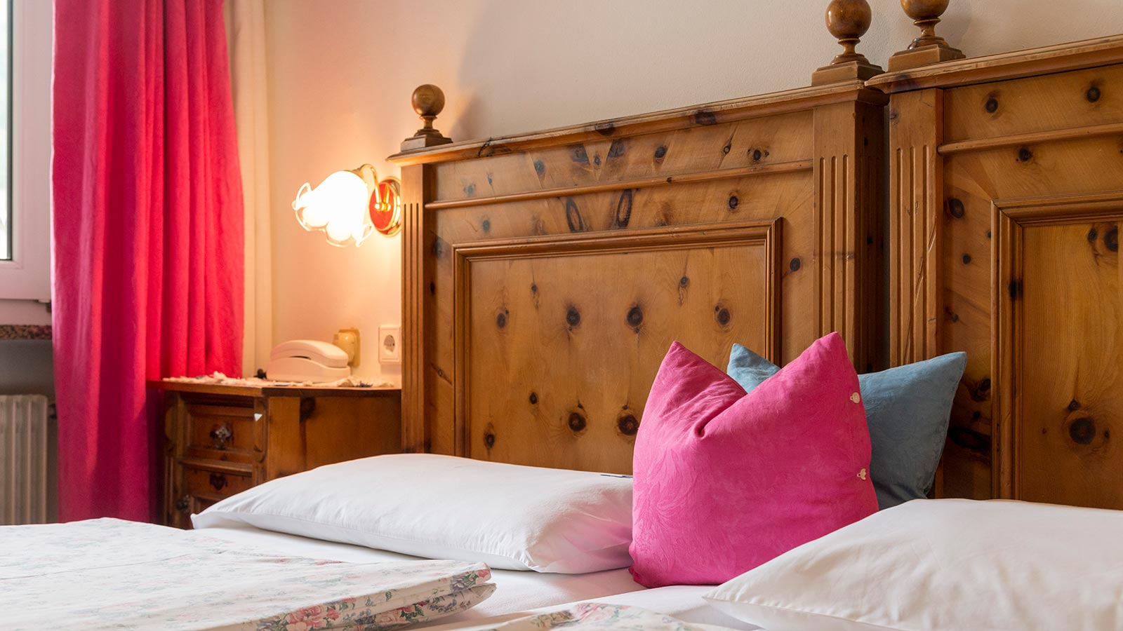 Comfortable bed at Garnì Letizia in San Candido